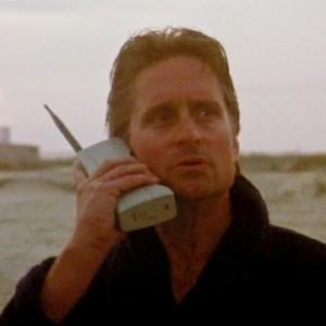 "Michael Douglas (as Gordon Gekko in the movie ""Wall Street"") holding a Motorola DynaTAC"